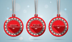 Merry Christmas on English, Spanish and Japanese Stock Photos