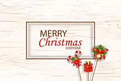 Merry christmas everyone concept for flyer, banner, invitation, card, congratulation or poster design with Jingle bells, candle ca. Ne, gift box on wooden Stock Photography