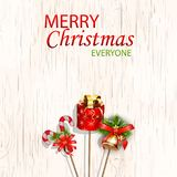 Merry christmas everyone concept for flyer, banner, invitation, card, congratulation or poster design with Jingle bells, candle ca. Ne, gift box on wooden Stock Photo