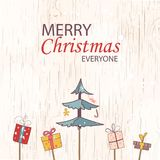 Merry christmas everyone concept for flyer, banner, invitation, card, congratulation or poster design with tree, gift box on woode. Merry christmas everyone Royalty Free Stock Photography