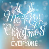 Merry Christmas Everyone handwritten text on blurred background. Stock Photos