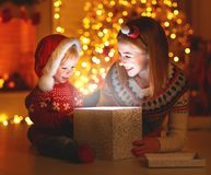 Merry Christmas! family mother and child with magic  gift  at ho Stock Image