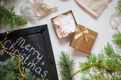 Merry Christmas feast background. Golden gift box on the celebra. Te white background Stock Photo