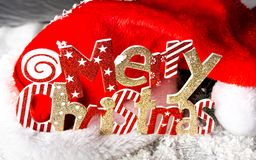 Merry Christmas festive background card with Santa hat. Merry Christmas festive background card with red Santa hat royalty free stock photography