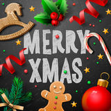 Merry Christmas festive background with gingerbread men and Christmas decoration Stock Photography