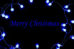 Merry Christmas Blue Lights Frame. Merry Christmas with Festive Frame made of Blue Lights Stock Photo