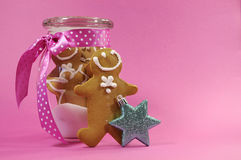 Merry Christmas festive gingerbread men in glass cookie jar with copy space Royalty Free Stock Image
