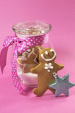 Merry Christmas festive gingerbread men in glass cookie jar cose up Royalty Free Stock Images