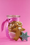 Merry Christmas festive gingerbread men in glass cookie jar - vertical Stock Photography