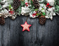 Merry Christmas Frame with green pine, colorful baubles and stars Royalty Free Stock Image