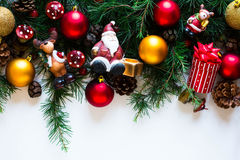 Merry Christmas Frame with real wood and colorful baubles Royalty Free Stock Photo