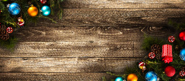 Merry Christmas Frame with real wood green pine and colorful baubles, stock image