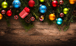 Merry Christmas Frame with real wood green pine and colorful baubles, Royalty Free Stock Images