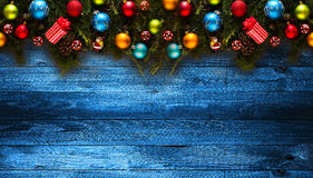 Merry Christmas Frame with real wood green pine and colorful baubles, Royalty Free Stock Photos