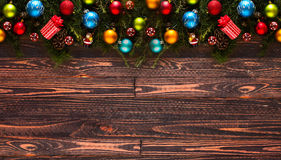 Merry Christmas Frame with real wood green pine and colorful baubles, Royalty Free Stock Photography