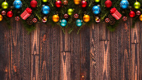 Merry Christmas Frame with real wood green pine and colorful baubles, Stock Photo