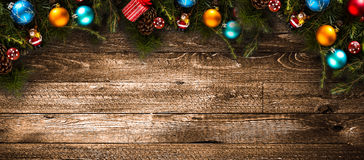 Merry Christmas Frame with real wood green pine and colorful baubles, Royalty Free Stock Image