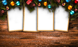 Merry Christmas Frame with real wood green pine, colorful baubles, gift boxe and other seasonal stuff over an old wooden aged back. Ground Royalty Free Stock Photography