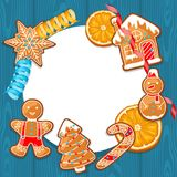 Merry Christmas frame with various gingerbreads orange and streamers.  Royalty Free Stock Photography