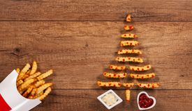 Merry christmas with french fries fast food xmas tree Stock Photo