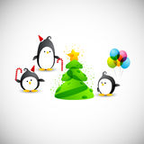 Merry christmas, funny penguins near the christmas Stock Image