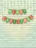 Merry christmas garland on white brick wall. Homemade flag garland with Merry Christmas text on white brick wall with lights and snow. LED Light Glowing bulbs Royalty Free Stock Photos