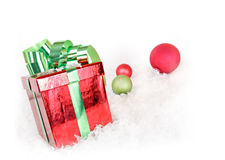 Merry christmas gift. A christmas gift with green ribbon and ornaments Royalty Free Stock Photography