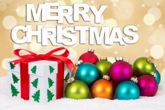 Merry Christmas gift decoration with golden background Royalty Free Stock Image