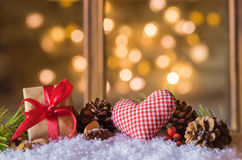 Merry Christmas. Christmas gift and heart with sparkle lights background stock photo