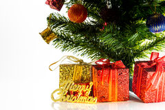 Merry Christmas gift on a table in the white background a Christmas Stock Photos
