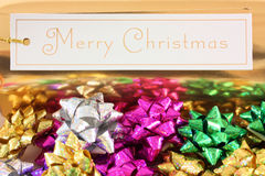 Merry Christmas gifts. Merry Christmas sign with gift bows royalty free stock images