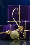 Merry Christmas gifts gold and violet ... Royalty Free Stock Photos
