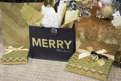 Merry Christmas Gifts and Presents underneath a Christmas Tree. Unopened presents, gifts, and bags set on the carpeted ground royalty free stock photo