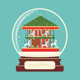 Merry christmas glass ball with carousel horses Royalty Free Stock Photography