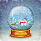 Merry christmas glass ball with snowmen Royalty Free Stock Images