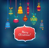 Merry Christmas Glass Balls on Blue Shining Background. Ribbon and label for text Stock Images