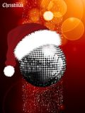 Christmas festive glowing background with disco ball and Santa h. Merry Christmas Glowing Red Festive Background with Silver Disco Ball with Santa Hat snow and Royalty Free Stock Photo