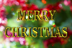 Merry Christmas Gold Bokeh. Merry Christmas message in gold letters with a vibrant bokeh background Stock Image