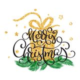 Merry Christmas gold glittering lettering calligraphy text with design on background of golden stilyzed gift.  Royalty Free Stock Photo