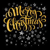 Merry Christmas gold glittering lettering design Stock Photo