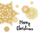 Merry Christmas gold glittering lettering design Stock Images