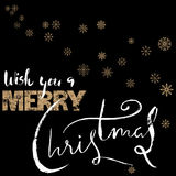 Merry Christmas gold and white lettering design on black background with golden snowflakes. Stock Image