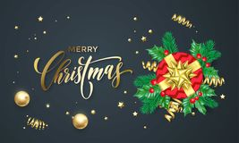 Merry Christmas golden decoration and gold font calligraphy greeting card design. Vector Christmas tree holly wreath decoration, N. Ew Year holiday red gift and Stock Images