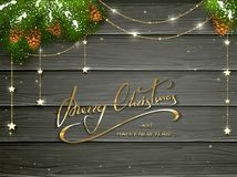 Merry Christmas and golden decorations on black wooden backgroun Stock Photos