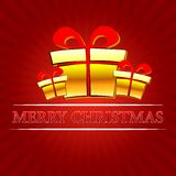 Merry christmas with golden gift boxes over red rays Royalty Free Stock Photo