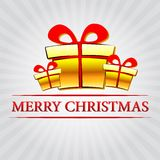 Merry christmas with golden gift boxes over silver rays Stock Photo