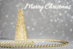 Merry Christmas golden pearl. Silver background royalty free stock images