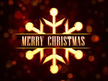 Merry Christmas in golden snowflake Royalty Free Stock Photo