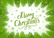 Merry Christmas on green background with fir tree brunches Stock Photography
