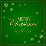 Merry Christmas on green background with snowflakes Stock Images